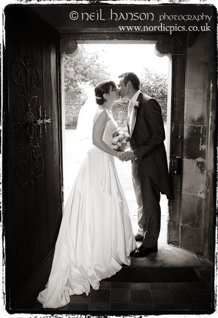 Bride & Groom kiss at their Bisham Abbey Wedding Ceremony by Neil Hanson Photography