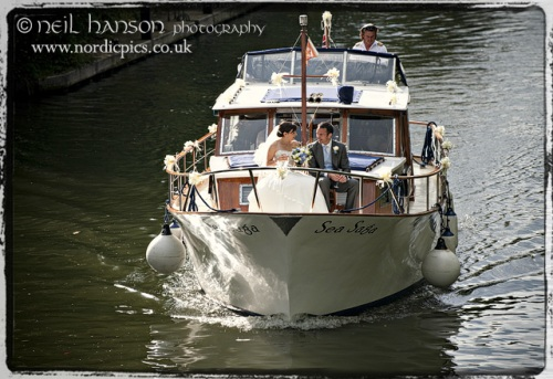 Bride & Groom on the River Thames near Bisham Abbey on their Wedding day by Neil Hanson Photography