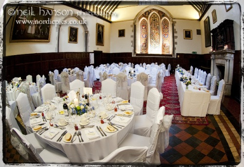 Great Hall at Bisham Abbey with Wedding tables laid out ready for Wedding Breakfast