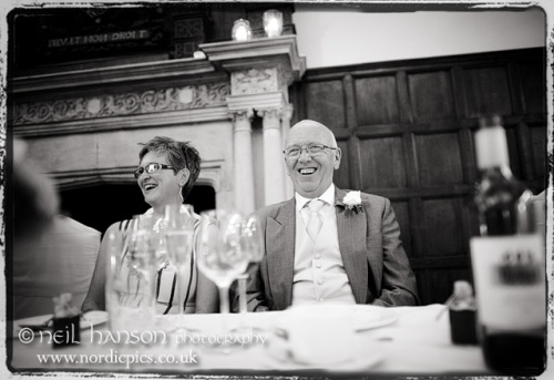 Guests enjoying the speeches at a Wedding at Bisham Abbey Berkshire by Neil Hanson