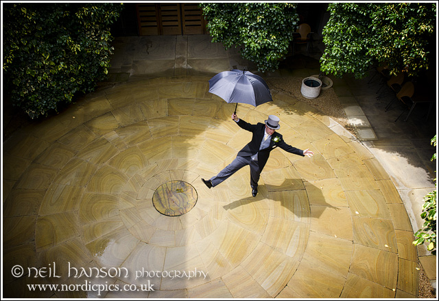 Groom singing in the rain at St John's College Oxford