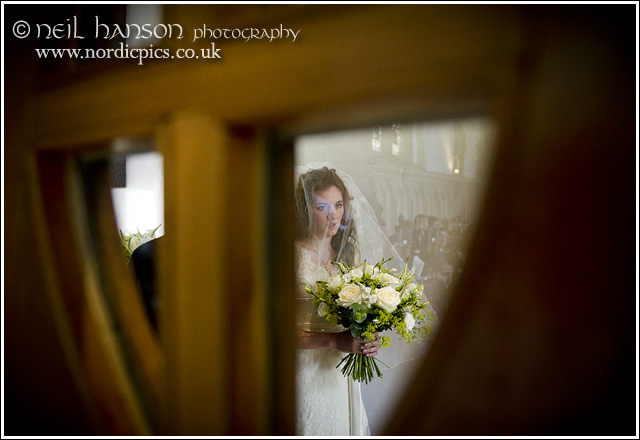 Bride waiting at the chapel entrance
