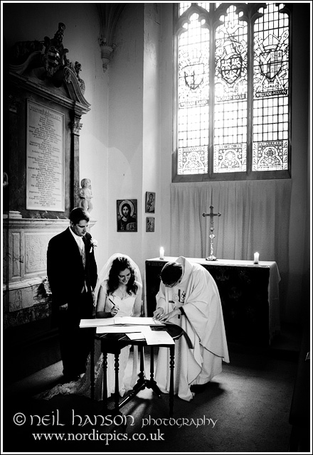 Signing the Marriage Certificate at St John's College Oxford