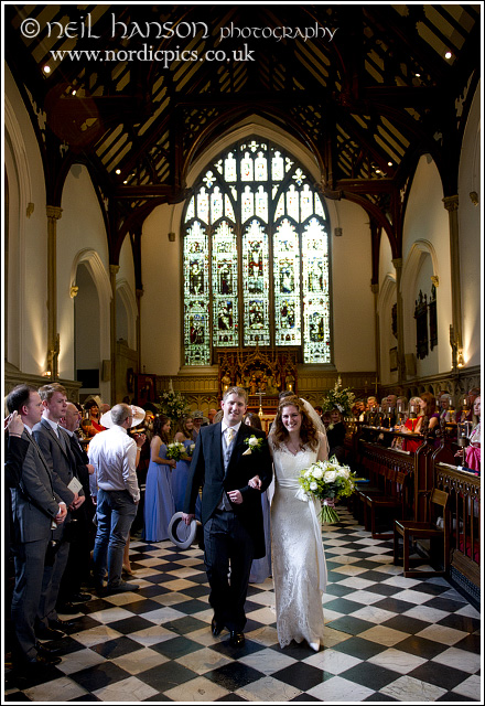 Bride & Groom exit St John's College Chapel wedding by neil hanson photography