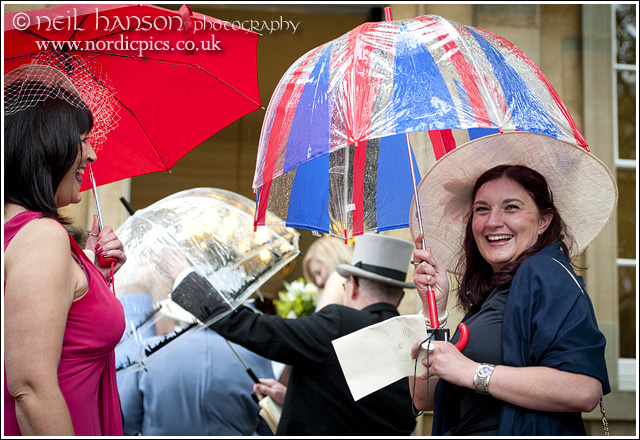 Union Jack brollies on a wet wedding day in oxford