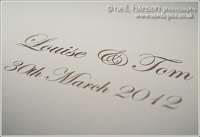 beautiful cover etching to real leather wedding albums by neil hanson photography at caswell house